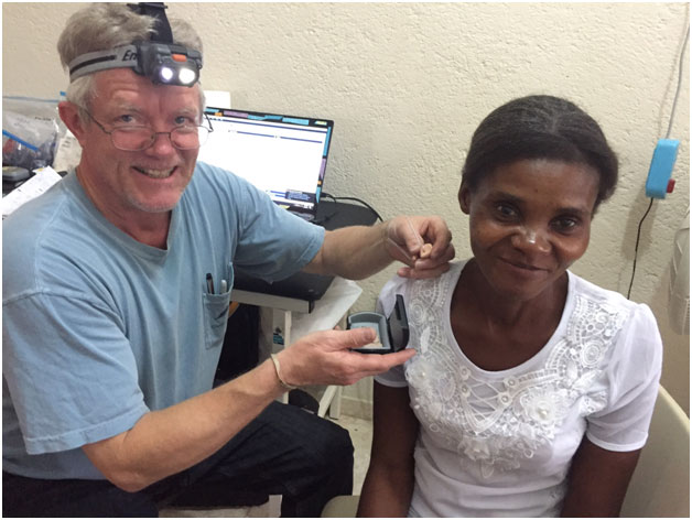 Kurt Chappell with Haitian hearing patient