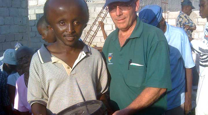 Dr. Fred Sorrells delivery clean water to earthquake victim