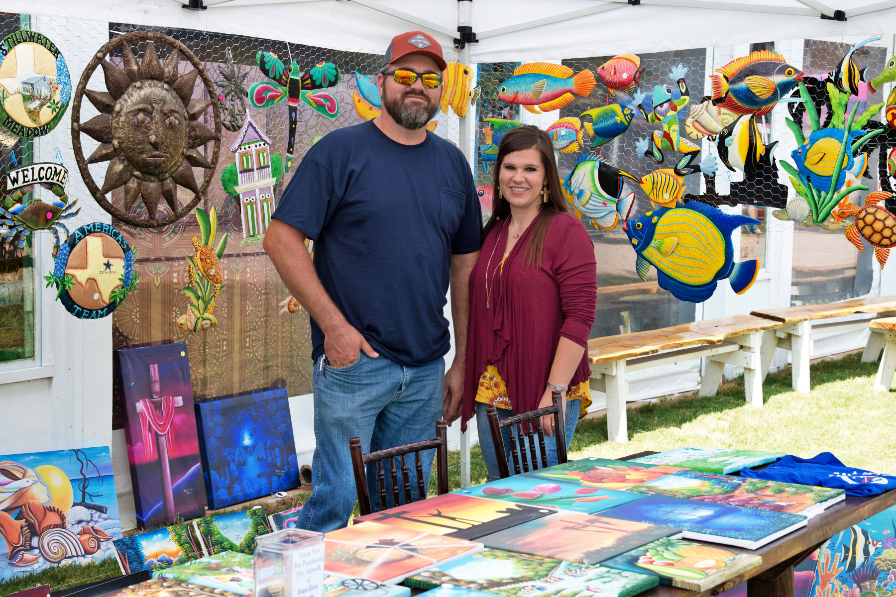 Joe and Jennifer Fails staff the Operation Go Quickly booth at the Aledo Art & Wine Festival