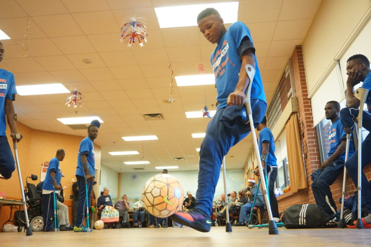 Veterans watch the Haitian's demonstrate amputee soccer.