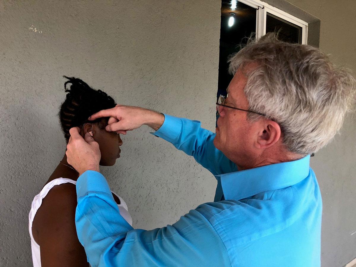Kurt Chappell fits Jennifer with new hearing aid